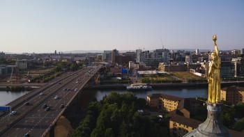 Golden Statue overlooking Motorway bridge Glasgow
