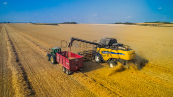 Combine Farm Harvest In The Summer
