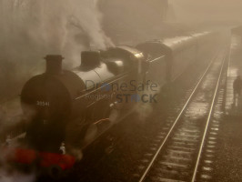 Atmospheric close up view of steam train locomotive