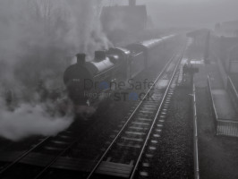 Black and White image of Steam Train in Railway station